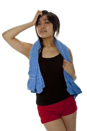 perspiring: Pretty young Asian woman with towel after fitness. Isolated on white, studio shot, closeup Stock Photo