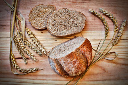 Fresh Rye bread and corns on the wooden table. View from above. Still life Stock Photo - 17172159