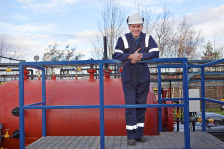 TPetrochemical contractor posingl in front of an oil refinery. Outdoor photo