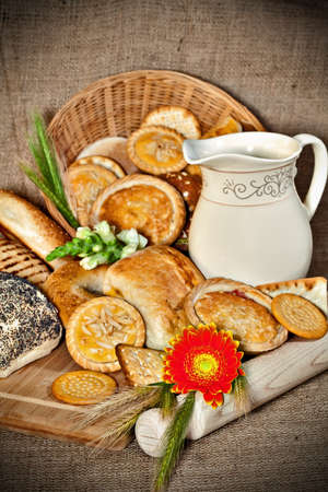 Vaus baked goods with a cutting board, wooden utensil and cereal ears Stock Photo - 17245260