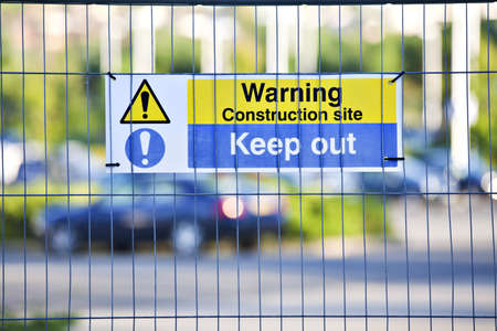 Warning, construction site. Keep Out sign on site fence.  Stock Photo