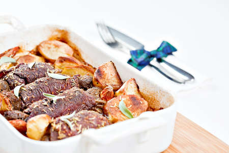 Tradicional Scottish Beef Olives stuffed with haggis and farm vegetables on white background.  photo