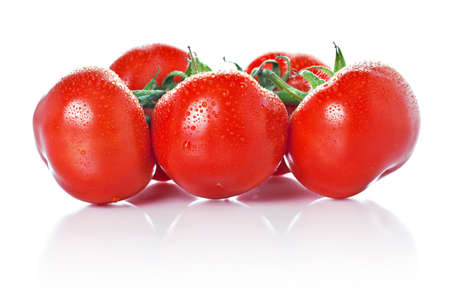 Closeup of vine tomatoes photographed on glass surface with reflection isolated against white background. Stock Photo - 17691492