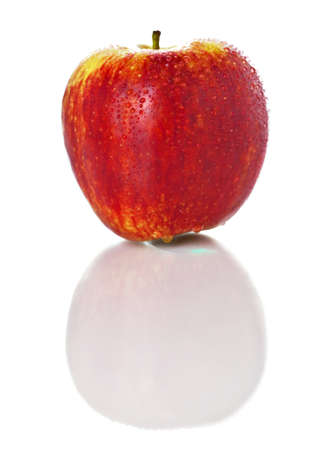 Sweet ripe red apple photographed on glass surface with reflection isolated on white background Stock Photo - 17691485