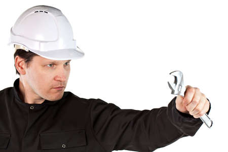 One adult male handyman professional technician repairman wearing black coveralls uniform and white hardhat with spanner tool. Isolated on white background photo