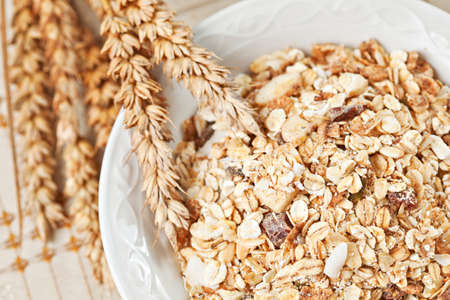 Healthy eating breakfast low calories bowl of swiss muesli. Above point of view, closeup Stock Photo - 18651274