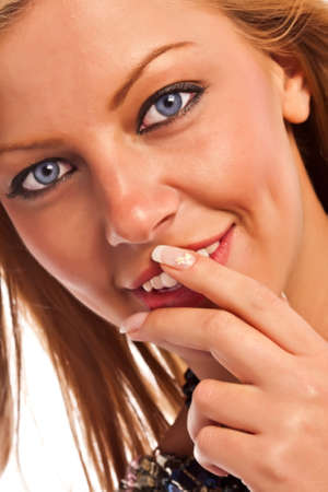 Closeup of a caucasian sensual girl's face and fingers with manicure Stock Photo - 18785504