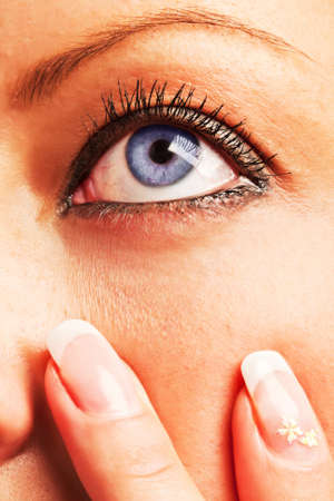 Closeup of a caucasian girl's blue eye and fingers with manicure Stock Photo - 18785492
