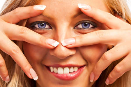 Closeup of a caucasian sensual girl's face and fingers with manicure Stock Photo - 18785499