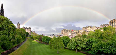 Rainbow over Princess street gardens with Scott Monument, and the North Bridge. Edinburgh, Scotland. More Scottish landscapes and landmarks in my portfolio Stock Photo