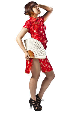 slit: Chinese model in traditional Cheongsam dress with slit, holding fan Stock Photo