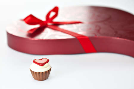 fancy sweet box: Chocolate cupcake bonbon with heart and red heart-shaped box with ribbon bow. More Valentine theme images in my portfolio