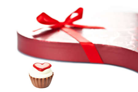 Chocolate cupcake bonbon with heart and red heart-shaped box with ribbon bow. More Valentine theme images in my portfolio photo