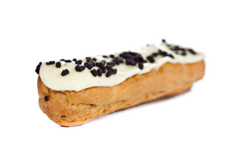 creampuff: Beautiful fresh baked eclair with vanilla frosting and chocolate chips Stock Photo