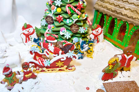 chritmas: Happy gingerbread people and snowman gathered by chritmas tree greating Santa Claus as Christmas fun decoration