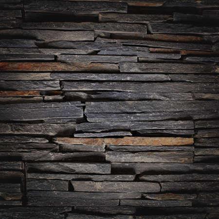 Staplade Skiffer Stone Wall Sqare texturerad bakgrund