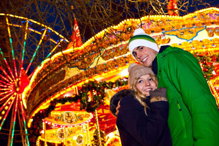 Young couple girl and man having good time on their date at German Christmas market Stock Photo - 23329211