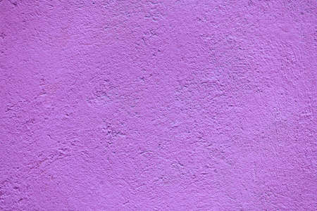 solid background: Fragment of magenta concrete facade wall texture