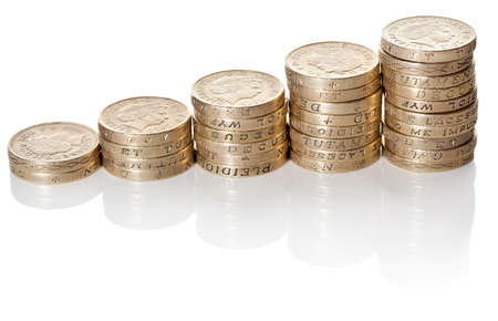 British pound sterling coins stack in columns symbolizing wealth growth