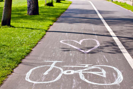 Bicycle symbol drawed with chalk on city cycling route lane