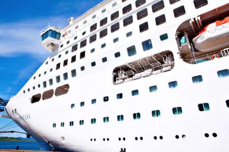 GREENOCK, SCOTLAND UK – JULY 09  Bow of white modern mega cruise ship docked at sea port  Greenock port, Scotland, July 29, 2013