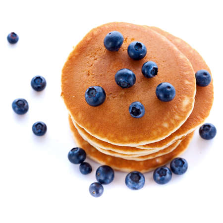 Stack pile of fresh pancakes with blueberries for breakfast on white background