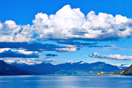 maggiore: View over Lake Maggiore and Swiss Alps mountains from Italian side in Northern Italy. Stock Photo