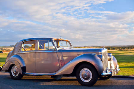shorter: GULLANE, SCOTLAND - SEPTEMBER 5, 2013: The Bentley Mark VI 4-door standard steel sports saloon was the first post-war luxury car from Bentley. Production 1946–1952, 5208 produced. This shorter wheelbase chassis and engine was a variant of the Rolls-Royc Editorial