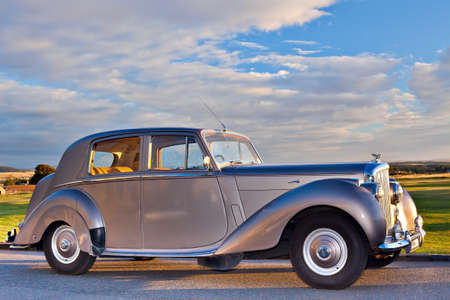 postwar: GULLANE, SCOTLAND - SEPTEMBER 5, 2013: The Bentley Mark VI 4-door standard steel sports saloon was the first post-war luxury car from Bentley. Production 1946–1952, 5208 produced. This shorter wheelbase chassis and engine was a variant of the Rolls-Royc Editorial
