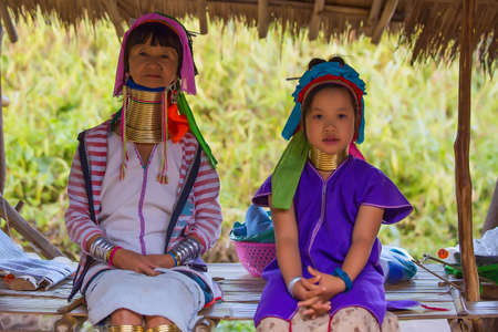originate: CHIANG RAI, THAILAND - JANUARY 2015: Unidentified Karen tribal old woman and girl near Mae Hong Son, Thailand, Chiang Rai. Padaung long neck hill tribe village, refugee community originate from neighboring Myanmar.