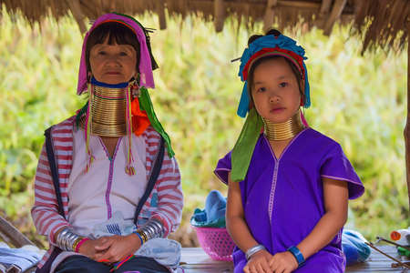neighboring: CHIANG RAI, THAILAND - JANUARY 2015: Unidentified Karen tribal old woman and girl near Mae Hong Son, Thailand, Chiang Rai. Padaung long neck hill tribe village, refugee community originate from neighboring Myanmar.