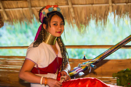 CHIANG RAI, THAILAND - JANUARY 2015: Karen tribal girl near Mae Hong Son, Thailand, Chiang Rai. Padaung long neck hill tribe village, refugee community originate from neighboring Myanmar. Editöryel