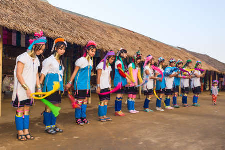 CHIANG RAI, THAILAND - JANUARY 2015: Karen tribal girls dressed in traditional costumes  performing national dance near Mae Hong Son, Thailand, Chiang Rai. Padaung long neck hill tribe village, refugee community originate from neighboring Myanmar.