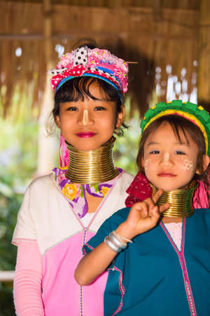 neighboring: CHIANG RAI, THAILAND - JANUARY 2015: Karen tribal girls near Mae Hong Son, Thailand, Chiang Rai. Padaung long neck hill tribe village, refugee community originate from neighboring Myanmar.
