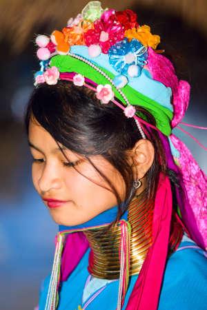 originate: CHIANG RAI, THAILAND - JANUARY 2015: Karen tribal girl near Mae Hong Son, Thailand, Chiang Rai. Padaung long neck hill tribe village, refugee community originate from neighboring Myanmar. Editorial