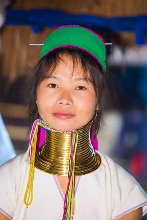 originate: CHIANG RAI, THAILAND - JANUARY 2015: Unidentified Karen tribal woman near Mae Hong Son, Thailand, Chiang Rai. Padaung long neck hill tribe village, refugee community originate from neighboring Myanmar.