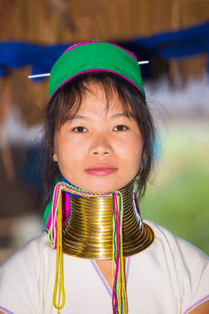 neighboring: CHIANG RAI, THAILAND - JANUARY 2015: Unidentified Karen tribal woman near Mae Hong Son, Thailand, Chiang Rai. Padaung long neck hill tribe village, refugee community originate from neighboring Myanmar.