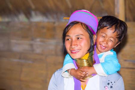 originate: CHIANG RAI, THAILAND - JANUARY 2015: Karen tribal woman with her child near Mae Hong Son, Thailand, Chiang Rai. Padaung long neck hill tribe village, refugee community originate from neighboring Myanmar. Editorial