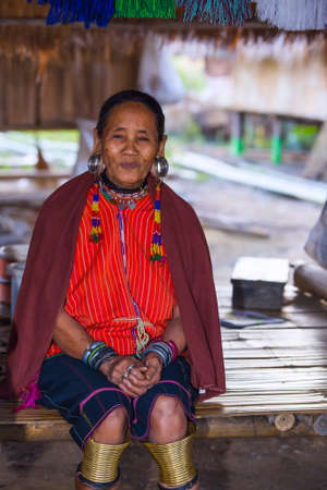 neighboring: CHIANG RAI, THAILAND - JANUARY 2015: Karen tribal old woman near Mae Hong Son, Thailand, Chiang Rai. Padaung long neck hill tribe village, refugee community originate from neighboring Myanmar.