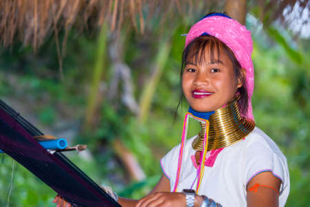 neighboring: CHIANG RAI, THAILAND - JANUARY 2015: Karen tribal girl near Mae Hong Son, Thailand, Chiang Rai. Padaung long neck hill tribe village, refugee community originate from neighboring Myanmar. Editorial