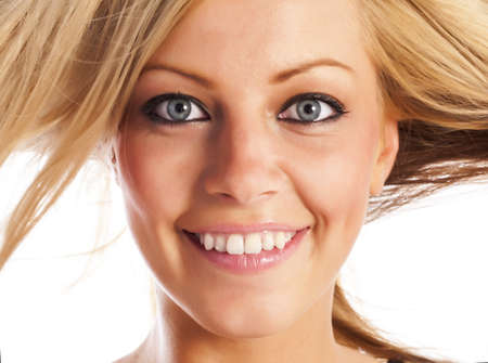 Caucasian european girl's face expressing cheerful emotions photo