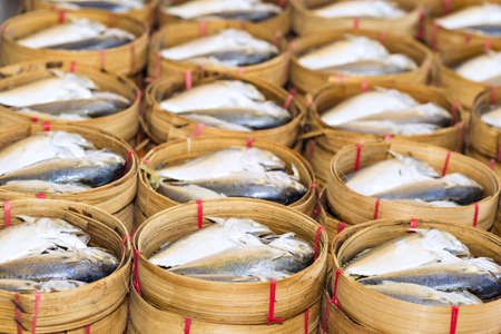 Steamed fish, Plaa Tuu (mackerel) in bamboo steamers at the seafood market