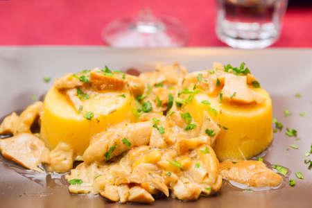 boletus mushroom: Polenta with boletus mushroom sauce. Italian authentic hot appetizer from Lombardy region