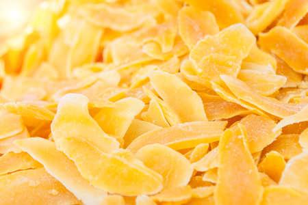 Heap of dried mango slices Фото со стока