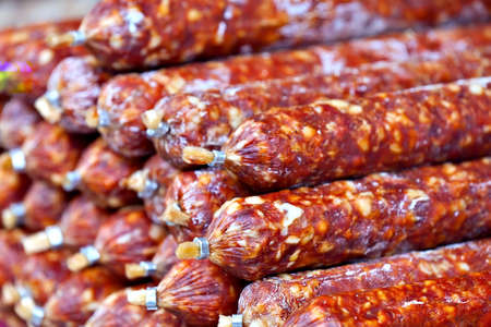 italian salami: Tasty home-made Italian salami sausages at the farmers market