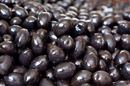 Marinated pitted black olives