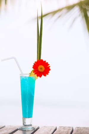 blue lagoon: Blue Lagoon cocktail on the table at tropical beach