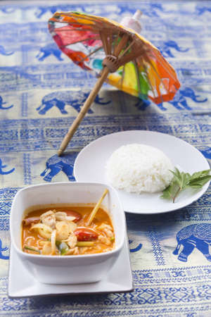 neighbouring: Tom Yum Goong soup - Thai the most famous Thai dish served with steamed rice. It is widely served in neighbouring countries such as Cambodia, Laos, Brunei, Malaysia and Singapore.