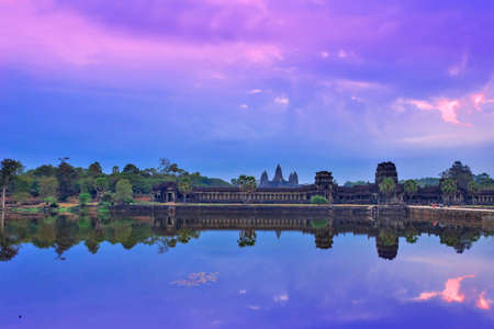 siem reap: Angkor Wat Temple complex view at the main entrance over the early morning sunrise sky. Located near Siem Reap, Cambodia