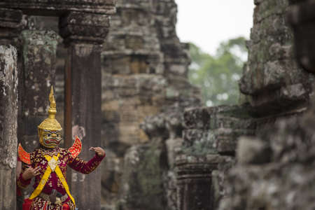 reenacting: Hindu cultural legend of deity with hands gestures reenacting by an actor in colorful costume at Bayon temple ruins, Angkor Wat, Siem Reap